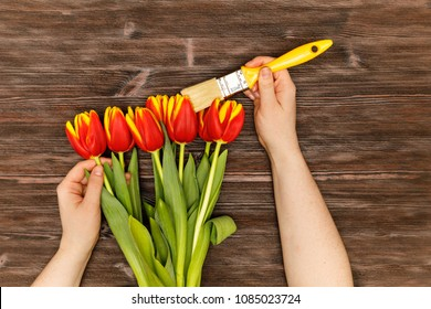 Repair color brush concept with spring flowers on the wooden table flatlay. Let's color the life