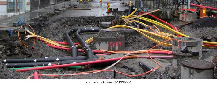 Repair of communications. Water supply, sewerage electrician. Excavated road in the city.