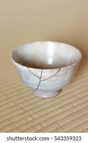 Repair of crack pottery tea cup  / vertical