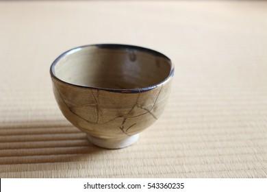 Repair of crack pottery tea cup  / horizontal