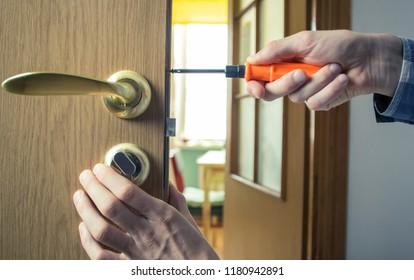 Repair of the door handle. Mounting the lock in the wooden door.