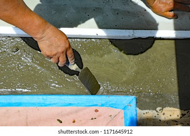 Repair of an expansion joint between two buildings involves caulking, and cement.  This is a new repair done by a professional.
