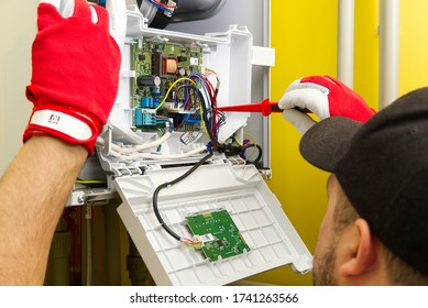 Repair of a gas boiler, setting up and servicing by a service department. Adjustment of gas boiler at domestic home. home repairs service concept.