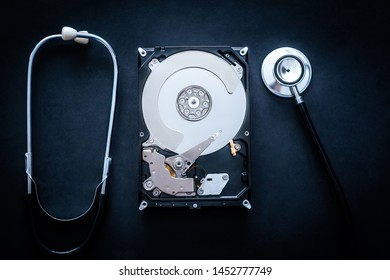 Repair of hard drive used for storage on personal computer on dark background