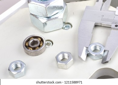 Repair of industrial equipment. Screwdriver, nuts and other accessory on aluminum surface.