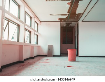 repair leak water pipe in under gypsum ceiling interior office building and bucket water