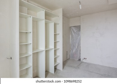 Repair in the living room of a new building, built-in wardrobe and closed by a cloth entrance to the room