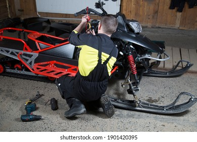 Repair and maintenance of snowmobiles. Maintenance of motor vehicles.