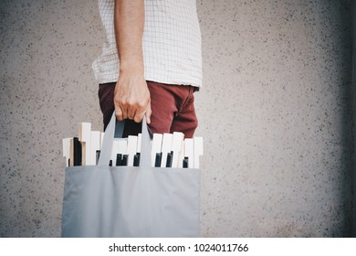 Repair man holding bag in bag have note music , piano