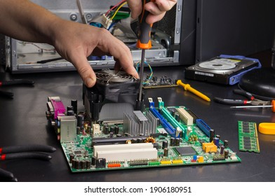 Repair of the motherboard in the service center. Replacing computer parts.