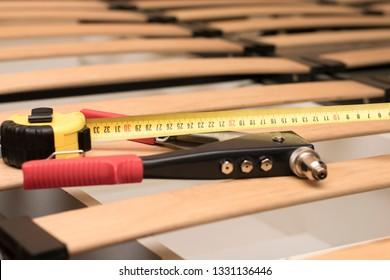 Repair orthopedic wooden bed base. Focus on centimeter