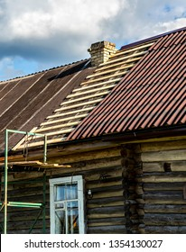 Repair the roof of a wooden house in the village