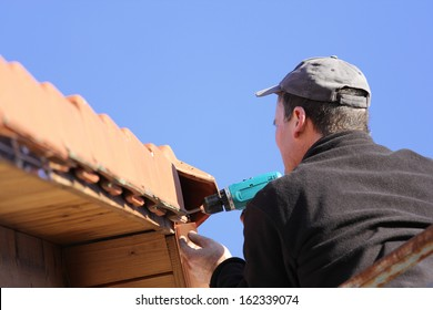 To repair the roof, worker