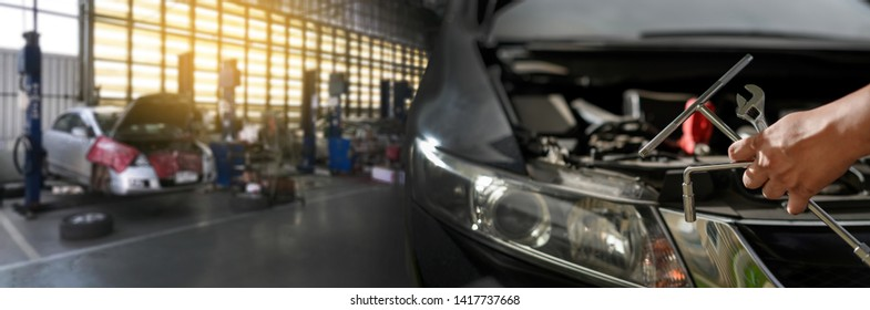 Repair service car Auto mechanic working in garage car mechanic with wrench in garage