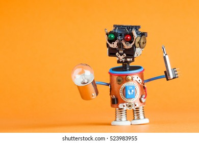 Repair service concept. Retro style robot handyman with screwdriver, lamp bulb. Fun toy character. Plastic head, colored green red eyes, electric wire hands, gears cog. Orange background, copy space