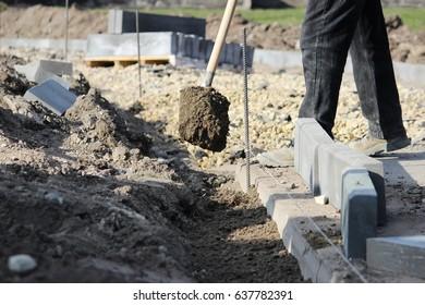 Repair of the sidewalk. Working stonemason repair the sidewalk, install curbs before for road before laying paving slabs