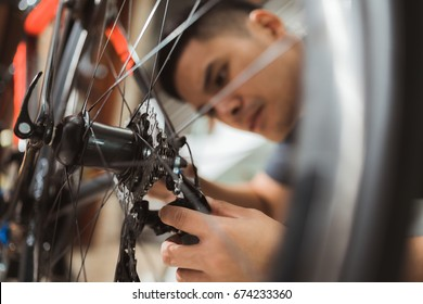 Repair technician bicycles was repaired gear bike shop.