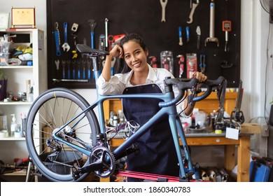 Repair technician woman bicycles was repaired gear bike shop.