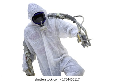 Repair tool in the white protect suit applies a construction foam from the gun to the roof of a warehouse.Spray polyurethane foam for roof - technician spraying foam insulation using plural component