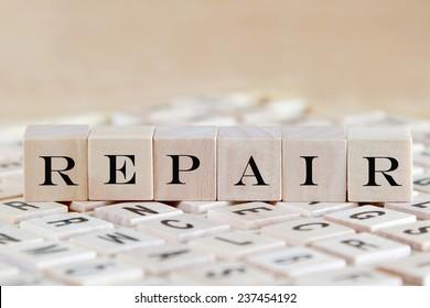 repair word background on wood blocks