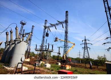 Repair work at the electrical substation, power substation, maintenance truck with the elevator for high-rise works