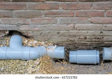 Repairing a broken sewage pipe / Plumbing