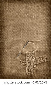 Repairing a canvas with a needle and thread