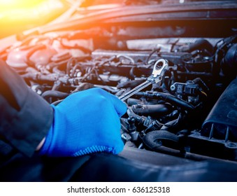 Repairing engine at service station. Car repair. Background