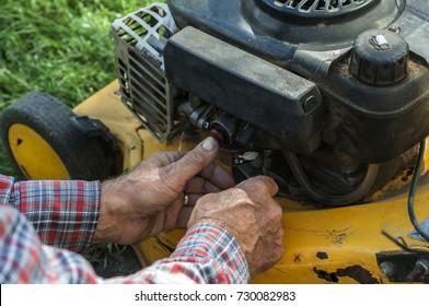 repairing lawn mower engine in close up