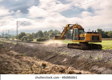 Repairing the railway line -Excavators on reconstruction of the railway rails