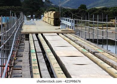 Repairing wooden road bridge