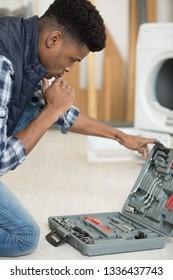 repairman choosing correct tool from his toolkit