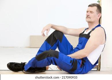 repairman having a break with his eyes closed
