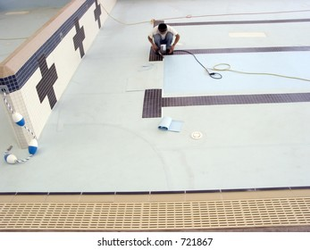 Repairman making repairs on a drained public pool