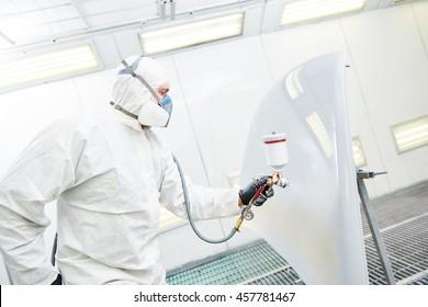 repairman painter in chamber painting automobile car bonnet