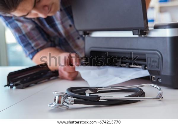 Repairman repairing broken color printer