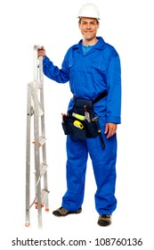 Repairman with a stepladder and tools bag standing against white background