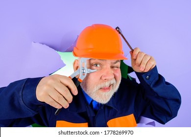 Repairment tools. Professional plumber holds pliers and wrench. Auto mechanic holds combination pliers. Builder with adjustable pliers looking through paper. Worker or builder in helmet with pliers.