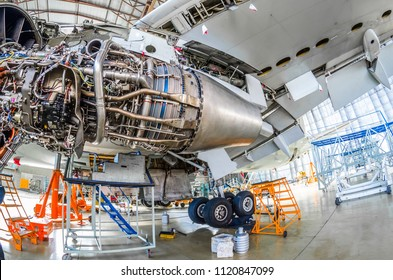 Repairs the maintenance of a large engine of a passenger aircraft in a hangar