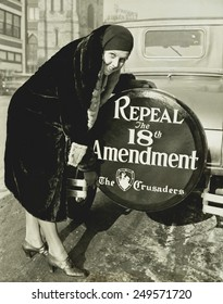 'Repeal the 18th Amendment' slogan on a spare tire cover. Dec. 16, 1930. Miss Elizabeth Thompson, was a member of 'The Crusaders', a national organization formed to overthrow prohibition.