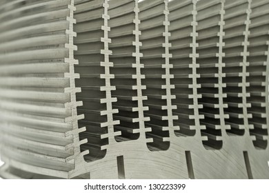 Repeated abstract patterns of an electronic heat sink