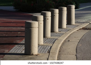 Repeated concrete columns in a turn in the road