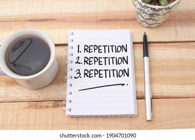 Repetition, text words typography written on book against wooden background, life and business motivational inspirational concept