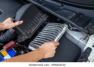 Replace old and dirty car air filters by hand.