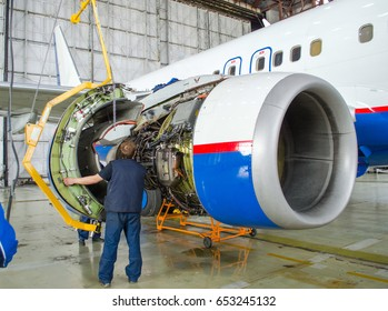Replacing the engine on the plane, working people tap. Concept maintenance of aircraft
