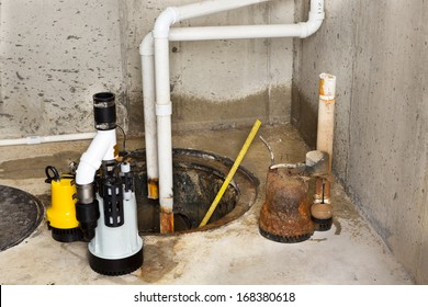 Replacing the old sump pump in a basement with a new one to drain the collected ground water from the sump or pit