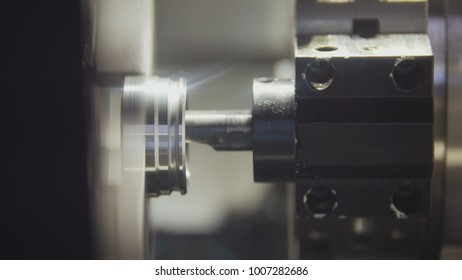 Replacing and placing the metal parts in the lathe for machining