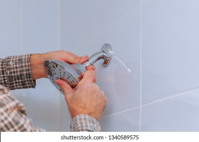 Replacing the plumbing in the bathroom mounted hand shower holder with height adjustable a shower head.