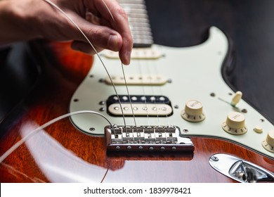 Replacing strings on an electric guitar