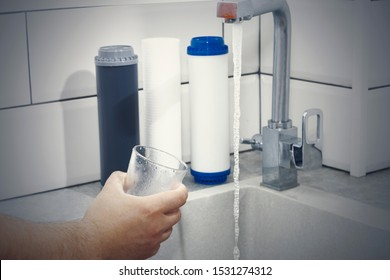 Replacing the water filter. Ecology. Clean water.